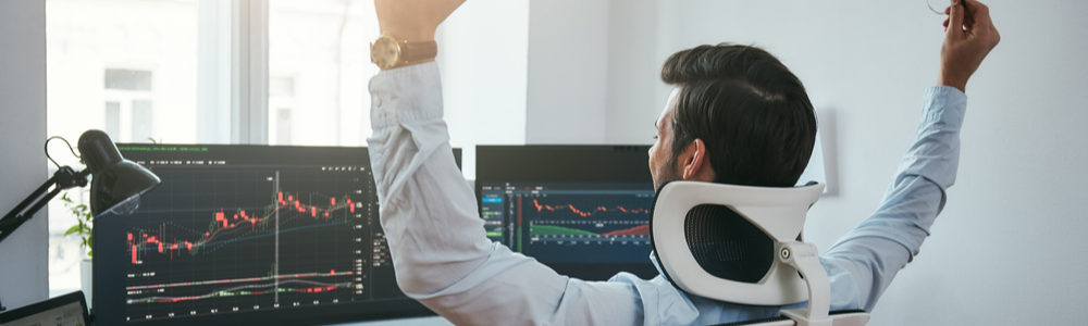 Guy Trading on Computer